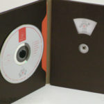 Custom Disc Packaging with die cut windows and fiberboard stock