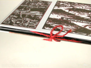 DVD book packaging with string tie