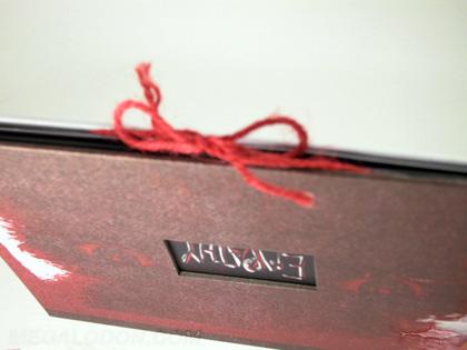 string tie closure on dvd book packaging with die cut window showcasing embossing