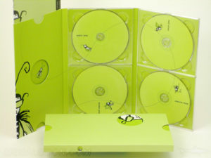 Multidisc Set 6pp MegaTall Digipak 4disc set, 4 clear trays, one tall booklet slot with diecuts, and a slipcase with spot uv gloss matte lamination effect