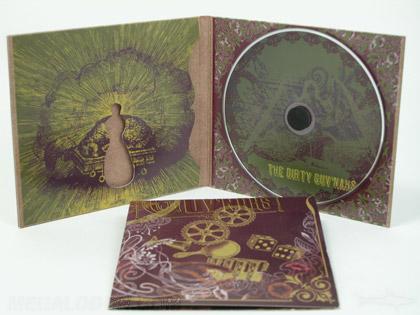 Die cut shape on custom cd packaging made with fiberboard stock and foam hub