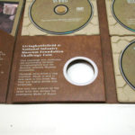 Organic dvd packaging, 3 dvd set, paper trays, die cut hole, fiberboard stock