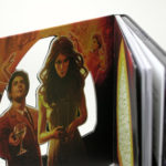 die cut in custom digipak front panel with perfect bound book inside
