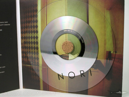 Clear substrate cd on cork hub cd jacket organic pacakging