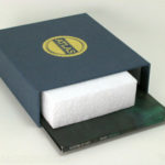 Linen wrapped box slipcase set with foam filler shown