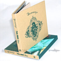 Fabric wrapped cd book shown by itself and with full color slipcase