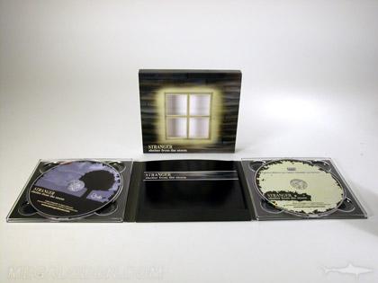 Die cut windows in slipcase set with 6pp digipak 2 cds