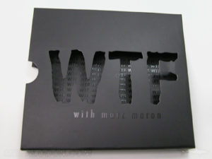 Die cut lettering spot uv gloss printing and matte lamination on slipcase inside
