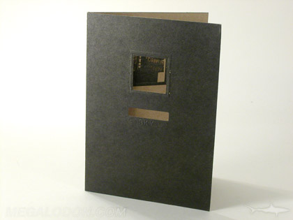 Custom die cut fiberboard folder with cutouts to reveal image and business card title
