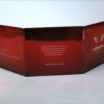 Title showing red foiling paper back side of package