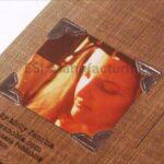 Embossed photo on the back of vintage scrapbook looking cd packaging