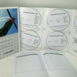 multi disc set slipcase box and notebook