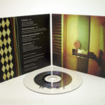 Organic CD jacket with cork hub, clear substrate cd