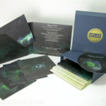 Linen Slipcase set with gold foil stamping, uncoated stock digipak with art cards