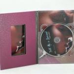 Custom die digipak with die cut window in panel showcasing booklet image