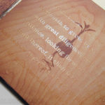 spot gloss applied over lettering on cd digipak with wood finish effect