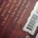 Embossed artwork, Spot gloss matte lamination on lettering on cd digipak