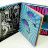 Deluxe Box Set packaging, 8 x 8 inch hinged box, swinging fold out sleeves to hold discs, large perfect bound book in back, Lenon Bermuda title